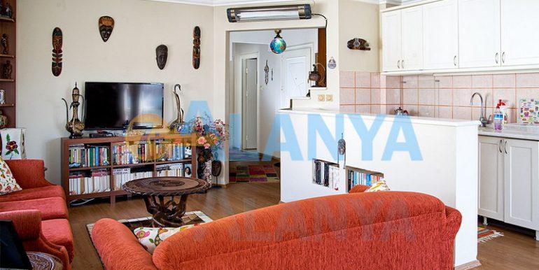 Недвижимость в Аланье. Апартаменты 2+1, гостиная и кухонная зона.
