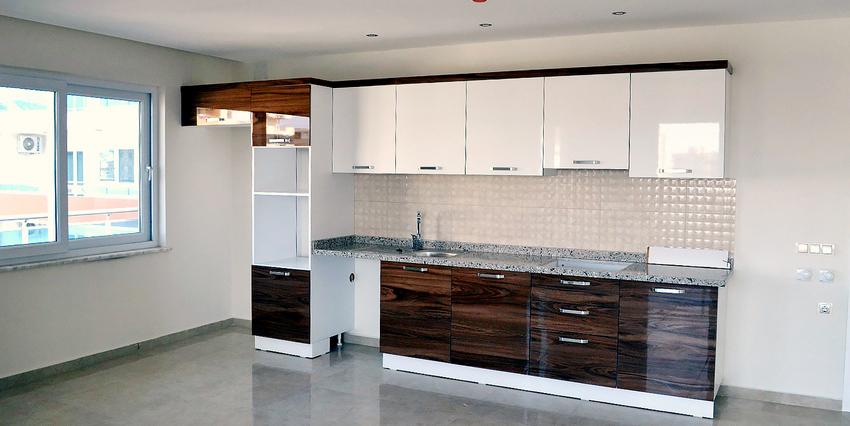 Двухкомнатная квартира в Махмутларе - кухня