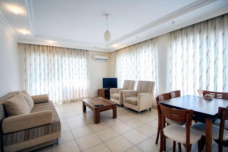 Трехкомнатная квартира в Olive city - гостиная