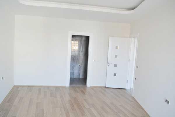Квартира с чистовой отделкой. Без мебели в Махмутларе.